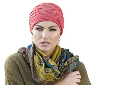 Woman wearing coral embedded rose detail on soft chemo cap