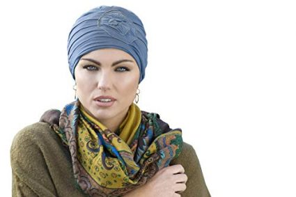Woman wearing blue embedded rose detail on soft chemo cap