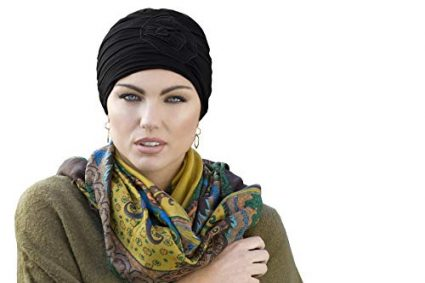 woman wearing black rose embedded chemo cap