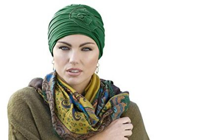 woman wearing green rose embeded chemo cap