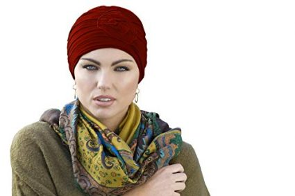 Woman wearing red embedded rose detail on soft chemo cap