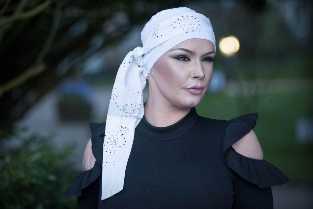 Woman wearing white chemotherapy headwear
