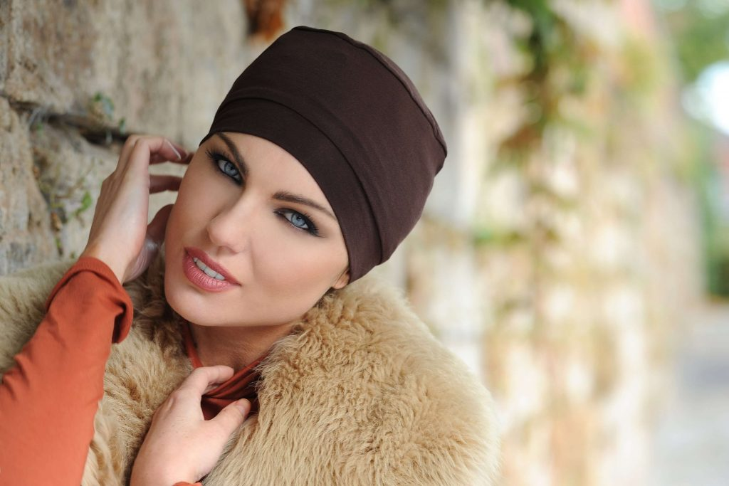woman wearing simple brown chemo hat