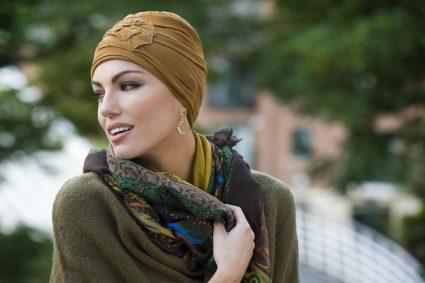 woman wearing green brown chemo headwear