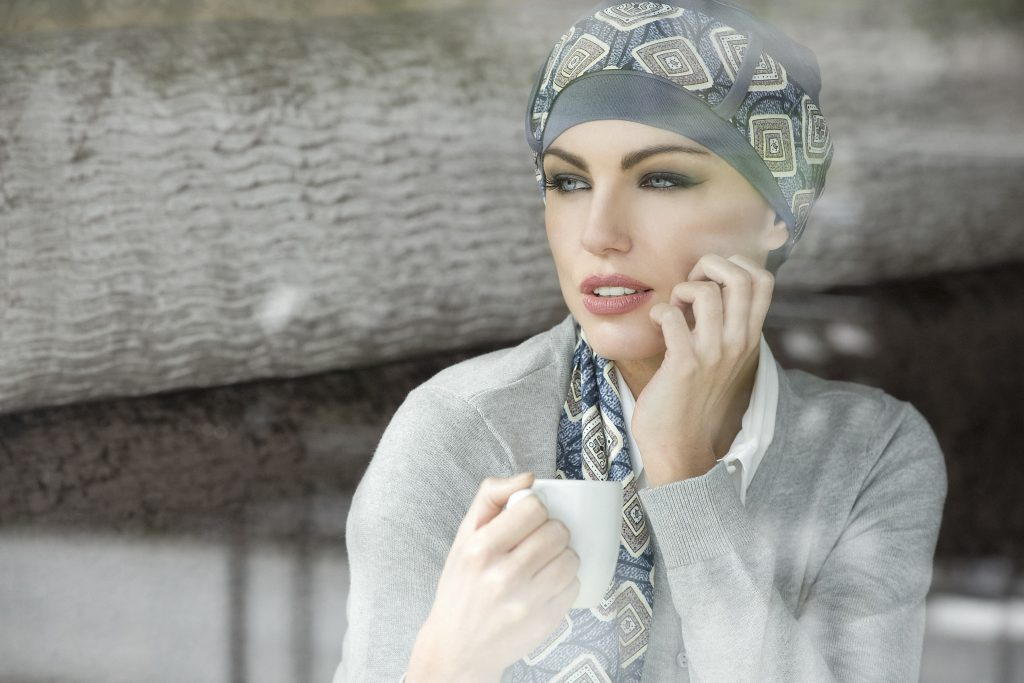Women's turban hats Yanna grey diamond woman wearing grey patterned chemo headwear