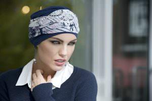 Woman wearing navy chemo headwear