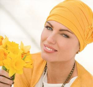 Woman wearing yellow embedded rose detail on soft chemo hap.