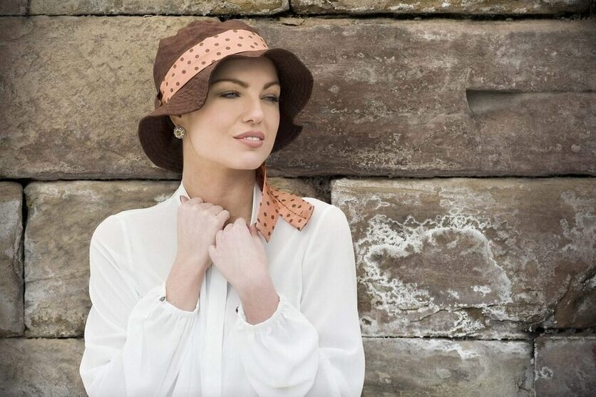woman wearing lola brown chemo hat for summer