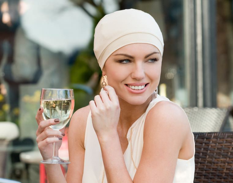 woman wearing basic nude chemotherapy hat