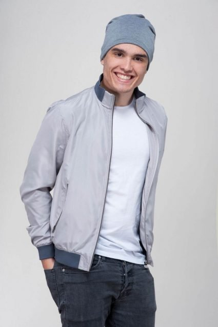A man wearing soft grey beanie hat.