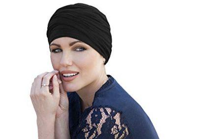 woman wearing black chemo cap scarlet