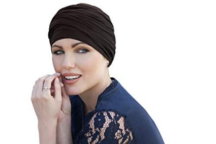 woman wearing brown scarlet ruffled chemo cap
