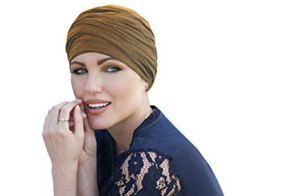 woman wearing camel colored scarlet ruffled chemo cap