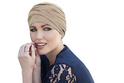 woman wearing champagne colored scarlet ruffled chemo cap