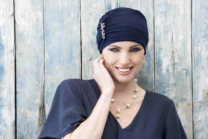 woman wearing navy chemo cap with jewel
