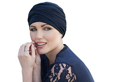 woman wearing navy colored scarlet ruffled chemo cap