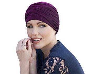woman wearing purple colored scarlet ruffled chemo cap