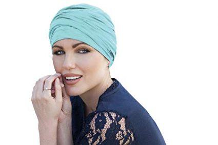 woman wearing scarlet light blue chemo cap ruffled