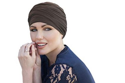 woman wearing taupe colored scarlet ruffled chemo cap