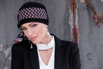 Chemotherapy scarf Yanna Black Scarlett Florenza Woman wearing black chemo hat with a delicately printed scarf