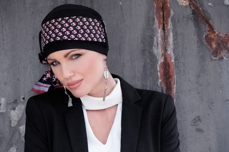 Chemotherapy scarf Yanna Black Scarlett Florenza Woman wearing black chemo hat with delicate printed scarf