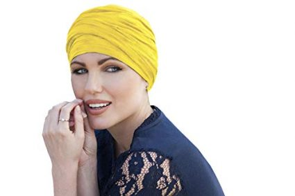 woman wearing yellow scarlet ruffled chemo cap