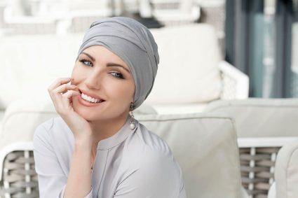 woman wearing scarlet grey chemo hat