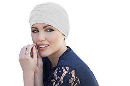 woman wearing white chemo cap scarlet