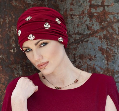 Woman wearing red embellished headwear