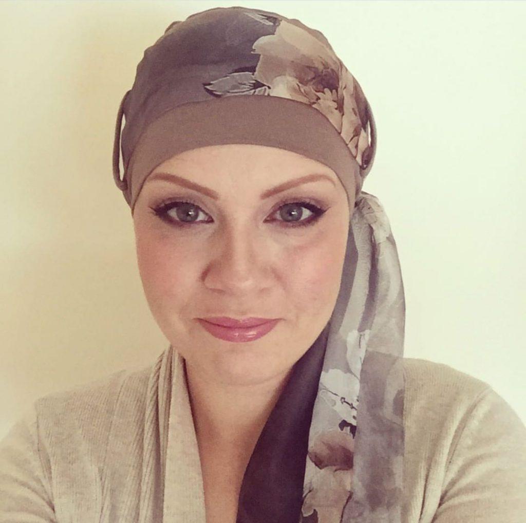 woman wearing yanna light brown floral chemo headwear