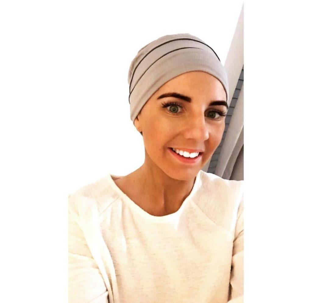 woman wearing brooklyn silver and grey chemo headwear