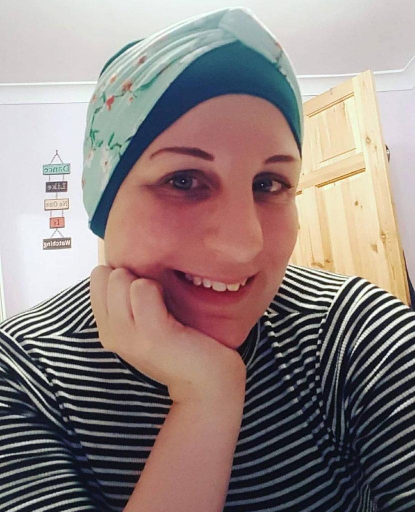 woman wearing ella green chemotherapy headwear