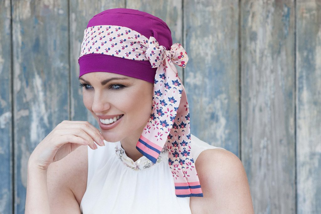 Stylish head scarves for cancer patients Yanna Purple Blush Florenza Woman wearing printed bow tie around the purple cap