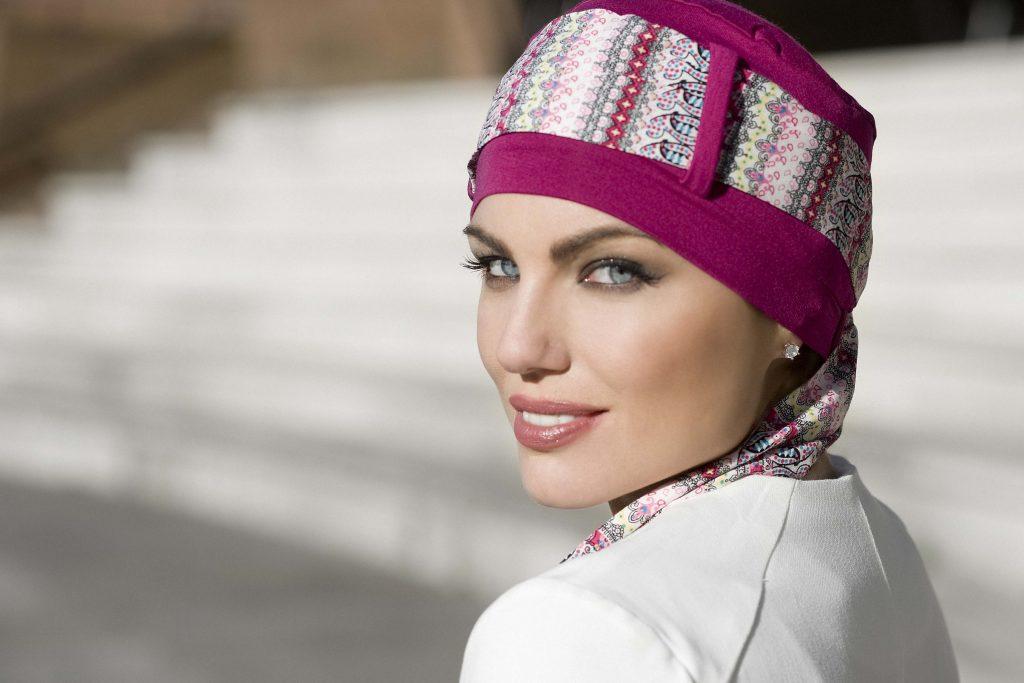 Stylish chemo scarf Yanna Purple Mosaica Woman wearing purple head cap with patterned scarf