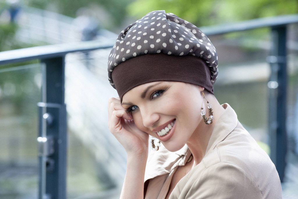 Woman wearing Brown polka dot hat
