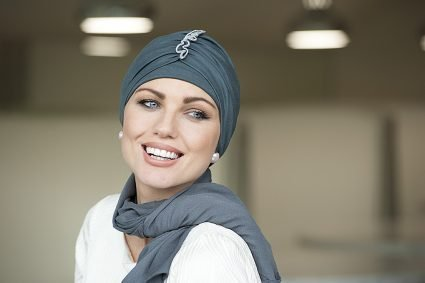 woman wearing iris blue headscarf