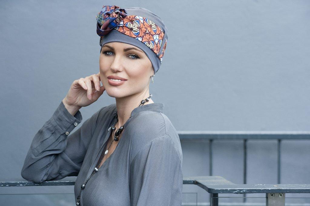 Woman wearing grey headwear with mosaic tie