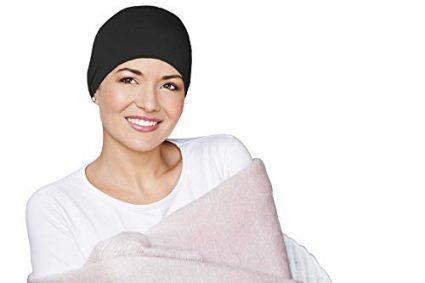woman wearing black chemo sleeping hat