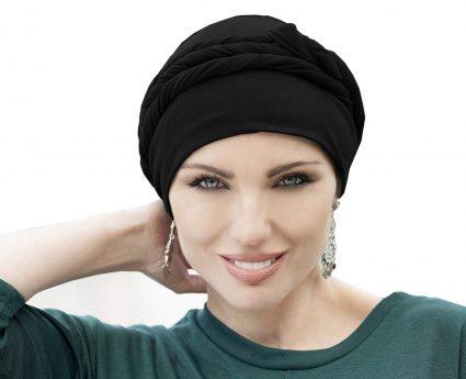 woman wearing black tied chemo hat asha