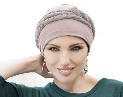 woman wearing asha champagne colored tied chemo hat