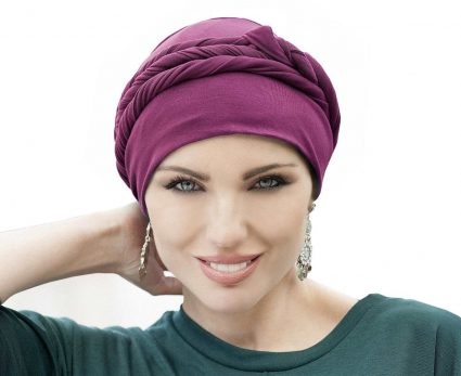 woman wearing purple tied chemo hat