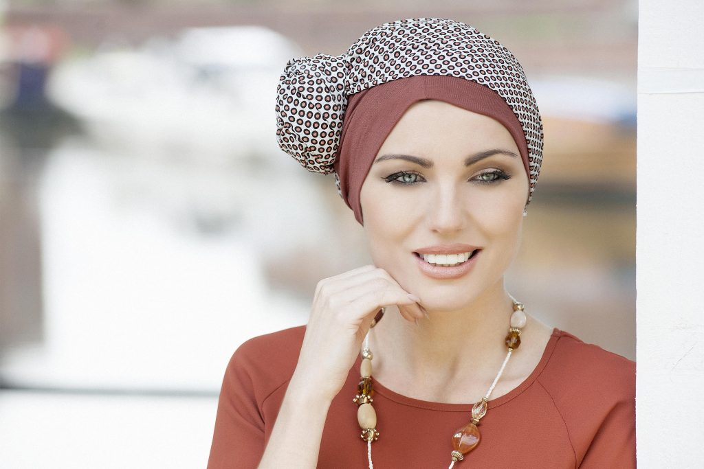 Headwear for cancer patients Daisy Brick Polka Dot Woman wearing brick soft cotton chemo hat with polka dot scarf