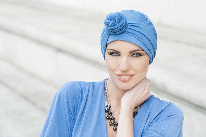 woman wearing blue chemo headwrap asha
