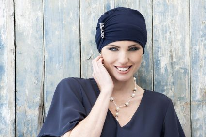 Woman is wearing a Hats for cancer patients UK – Iris Navy