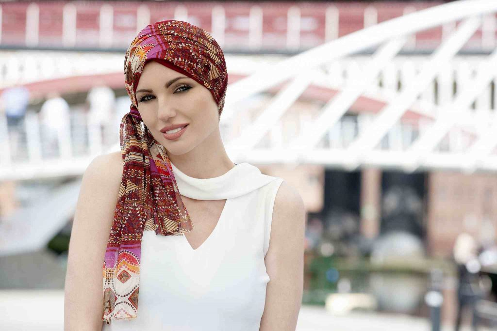 woman wearing red chemo headscarf mosaica