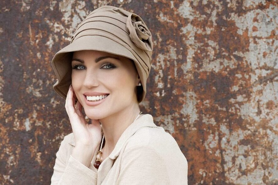 woman wearing rose embedded sun hat for cancer patients