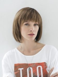 woman wearing dirty blonde bob wig