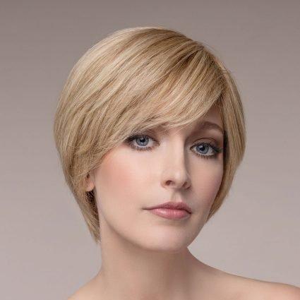 Woman wearing short sandyblonde human hair wig