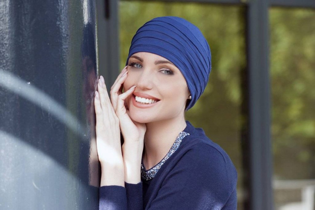Woman wearing Chemo hat with textured layers.