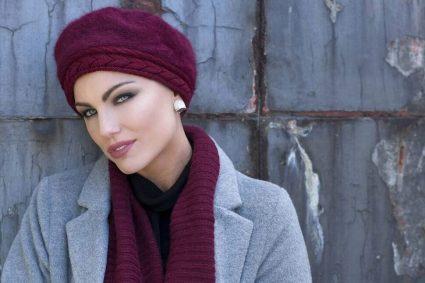 woman wearing maroon crochet chemo hat for winter